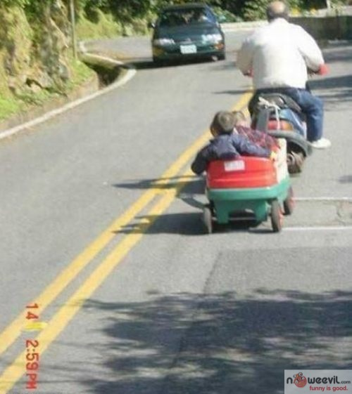 kids in trailer by motorcycle
