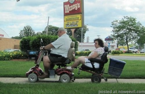 man towing wife on carts