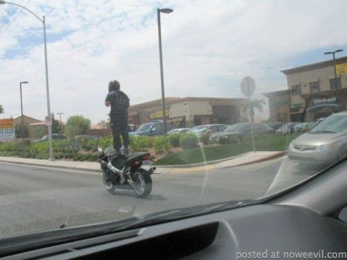 standing on motorcycle