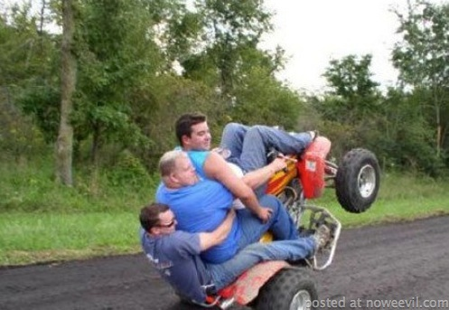 three guys on fourwheeler