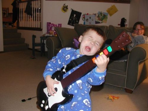 toddler and guitar hero