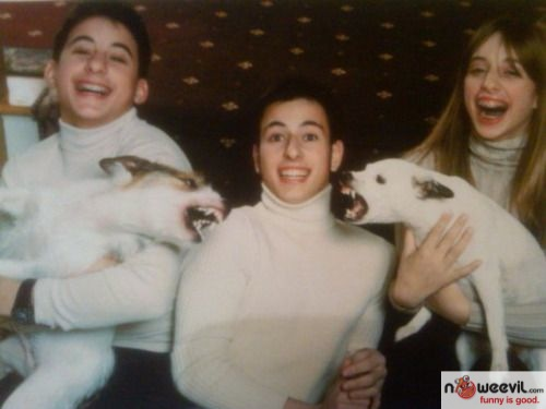 family pic with angry dogs