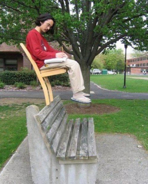 man balancing on chair