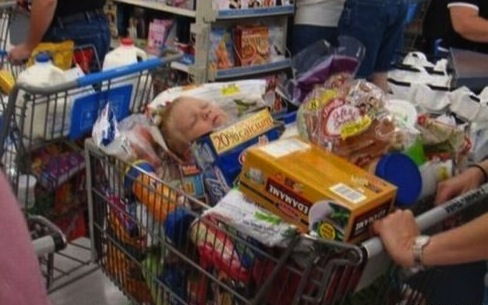 kid in cart