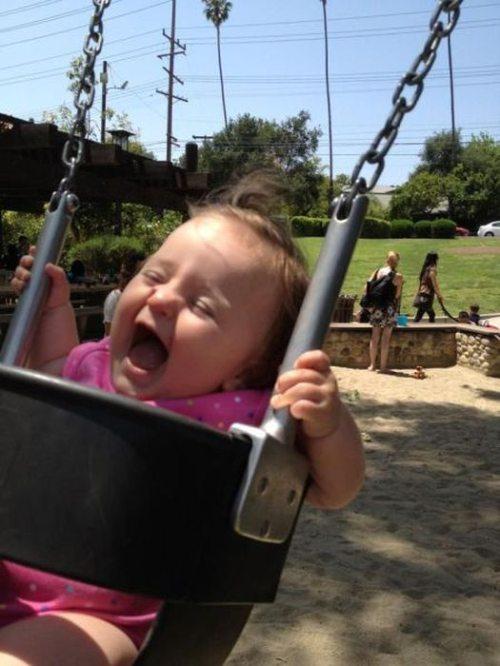 kid on swing
