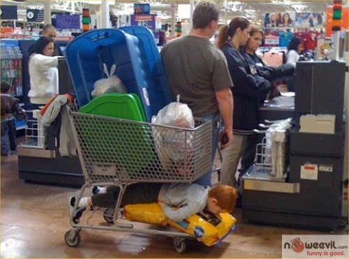 kid planking in cart