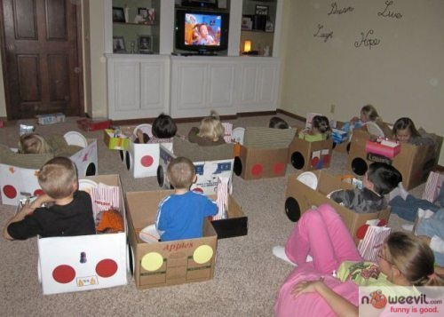 kids in boxes watching tv