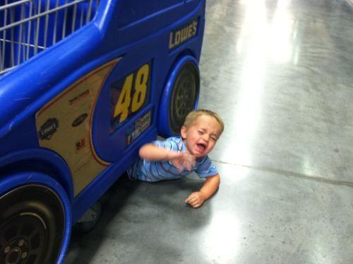 kid under cart